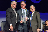 Yale President Peter Salovey and Athletics Director Thomas A. Beckett presenting Patrick Ruwe, M.D. '83. Yale Athletics Blue Leadership Ball & George H.W. Bush '48 Lifetime of Leadership Awards. 20 November 2015 at the William K. Lanman Center, Payne Whitney Gymnasium, Yale University.