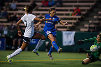 Seattle, Washington -  Sunday, September 11 2016: Seattle Reign FC midfielder Rumi Utsugi (20) takes a shot on goal during a regular season National Women's Soccer League (NWSL) match between the Seattle Reign FC and the Washington Spirit at Memorial Stadium. Seattle won 2-0.
