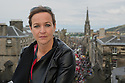 Edinburgh, UK. 21.08.2015. Kath M Mainland, Chief Executive of the Edinburgh Festival Fringe Society, on the roof of St Giles' Cathedral, overlooking the Royal Mile, busy with Fringe activity, during the Edinburgh Festival Fringe. Photograph © Jane Hobson.