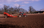 A913ME Tractor and trailer planting potato crop in field Suffolk sandlings England