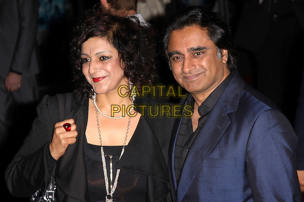 "MEERA SYAL & SANJEEV BHASKAR.The UK Premiere of ""The Imaginarium Of Doctor Parnassus"" at the Empire Leicester Square, London, England.  .October 6th, 2009 .half length black blue suit jacket ring silver necklaces red lipstick married husband wife .CAP/AH.©Adam Houghton/Capital Pictures."
