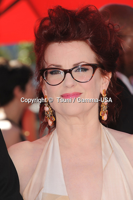 Megan MUllally  arriving  at the 2013 Primetime Creative Arts Emmy Awards  at the Nokia Theatre In Los Angeles.