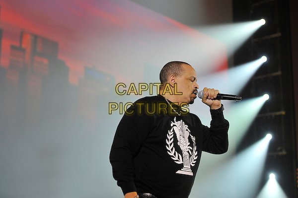 Ice T ( Tracy Marrow ) .performing at 'Something For Nothing: The Art of Rap'  European premiere, Hammersmith Apollo, London, England. 19th July 2012..show music live on stage concert gig.half length  black  top sweatshirt white microphone singing side .CAP/MAR.© Martin Harris/Capital Pictures.