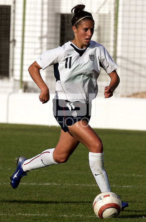 Carli Lloyd runs upfield during a Algarve Women's Cup soccer match between USA and China at the Silves Stadium in Silves, Portugal, March 7, 2007. USA won 2-1.