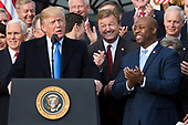 Speaker of The House Paul Ryan, Republican of Wisconsin, center left, United States Senator Dean Heller, Republican of Nevada, center, and United States Senator Tim Scott, Republican of South Carolina, center right, laugh as United States President Donald J. Trump speaks on the South Lawn of the White House surrounded by United States Vice President Mike Pence and Republican members of Congress after the United States Congress passed the Republican sponsored tax reform bill, the 'Tax Cuts and Jobs Act' in Washington, D.C. on December 20th, 2017. Credit: Alex Edelman / CNP