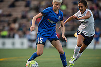 Seattle, WA - Sunday, September 11 2016: Seattle Reign FC forward Megan Rapinoe (15) and Washington Spirit defender Caprice Dydasco (3) during a regular season National Women's Soccer League (NWSL) match between the Seattle Reign FC and the Washington Spirit at Memorial Stadium. Seattle won 2-0.