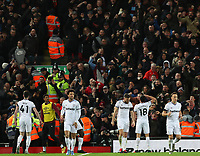 24th February 2020; Anfield, Liverpool, Merseyside, England; English Premier League Football, Liverpool versus West Ham United; Pablo Fornals of West Ham United celebrates in front of the visiting fans after beating Liverpool goalkeeper Alisson to give his side a 1-2 lead after 54 minutes
