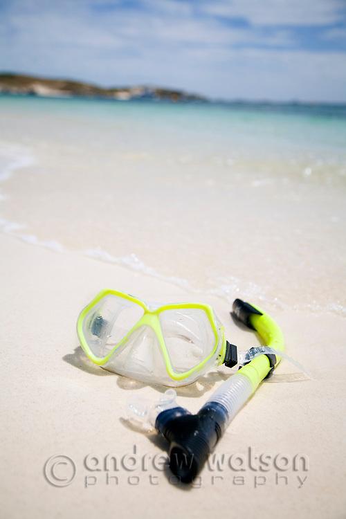 Mask and snorkel on the beach at Rocky Bay.  Rottnest Island, Western Australia, AUSTRALIA.