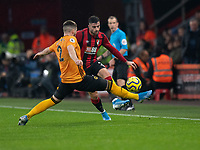 Bournemouth's Diego Rico (right) crosses the ball despite the attentions of Wolverhampton Wanderers' Matt Doherty<br /> <br /> Photographer David Horton/CameraSport<br /> <br /> The Premier League - Bournemouth v Wolverhampton Wanderers - Saturday 23rd November 2019 - Vitality Stadium - Bournemouth<br /> <br /> World Copyright © 2019 CameraSport. All rights reserved. 43 Linden Ave. Countesthorpe. Leicester. England. LE8 5PG - Tel: +44 (0) 116 277 4147 - admin@camerasport.com - www.camerasport.com
