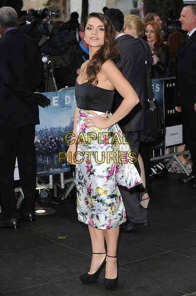 Charlotte Riley.'The Dark Knight Rises' European Premiere at The Odeon and Empire cinema, Leicester Square, London, England..18th July 2012.full length black top strapless white pink yellow floral print hand on hip side ankle strap shoes .CAP/BEL.©Tom Belcher/Capital Pictures.