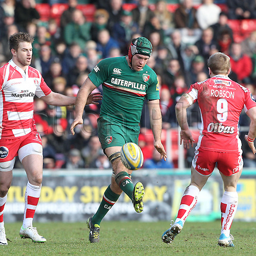 16.02.2014 Leicester, England. Leicesters Julian Salvi goes footballing during the Aviva Premiership game between Leicester Tigers and Gloucester Rugby from Welford Road Stadium.