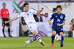 Farrukh Sayfiev of Uzbekistan (L) in action during the AFC Asian Cup UAE 2019 Group F match between Japan (JPN) and Uzbekistan (UZB) at Khalifa Bin Zayed Stadium on 17 January 2019 in Al Ain, United Arab Emirates. Photo by Marcio Rodrigo Machado / Power Sport Images