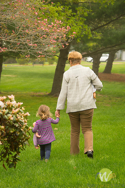 Grandmother with granddaughter in springtime.