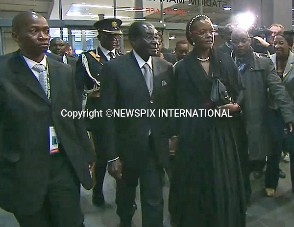 PRESIDENT ROBERT MUGABE OF ZIMBABWE<br /> NELSON MANDELA MEMORIAL<br /> The nation mourns Nelson Rolihlahla Mandela Memorial Service, FNB Stadium, Johannesburg, South Africa<br /> Mandatory Credit Photo: &copy;NEWSPIX INTERNATIONAL<br /> <br /> **ALL FEES PAYABLE TO: &quot;NEWSPIX INTERNATIONAL&quot;**<br /> <br /> IMMEDIATE CONFIRMATION OF USAGE REQUIRED:<br /> Newspix International, 31 Chinnery Hill, Bishop's Stortford, ENGLAND CM23 3PS<br /> Tel:+441279 324672  ; Fax: +441279656877<br /> Mobile:  07775681153<br /> e-mail: info@newspixinternational.co.uk