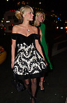 Socialites Paris Hilton and Nicky Hilton arrive at a benefit in Manhattan on October 17, 2001.