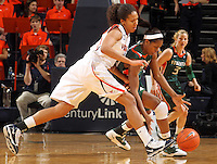 Jan. 6, 2011; Charlottesville, VA, USA; Miami Hurricanes forward Sylvia Bullock (34) steals the ball from Virginia Cavaliers center Simone Egwu (4) during the game at the John Paul Jones Arena.  Mandatory Credit: Andrew Shurtleff-
