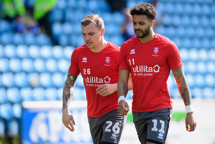 Lincoln City's Harry Anderson, left, with team-mate Bruno Andrade during the pre-match warm-up<br /> <br /> Photographer Chris Vaughan/CameraSport<br /> <br /> The EFL Sky Bet League Two - Carlisle United v Lincoln City - Friday 19th April 2019 - Brunton Park - Carlisle<br /> <br /> World Copyright © 2019 CameraSport. All rights reserved. 43 Linden Ave. Countesthorpe. Leicester. England. LE8 5PG - Tel: +44 (0) 116 277 4147 - admin@camerasport.com - www.camerasport.com