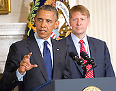 United States President Barack Obama delivers a statement in the State Dining Room of the White House in Washington, D.C. on the confirmation of Richard Cordray, right, as Director of the Consumer Financial Protection Bureau on Wednesday, July 17, 2013. <br /> Credit: Ron Sachs / Pool via CNP