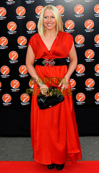 GAIL EMMS .Attending the Sport Industry Awards, .Battersea Evolution, London, England, UK, May 12th 2011..arrivals  full length red dress sleeveless black belt clutch bag long maxi .CAP/CJ.©Chris Joseph/Capital Pictures.