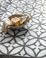 Omar, a hand-cut and waterjet stone mosaic, shown in polished Calacatta Tia and hand-chopped tumbled Cavern, was designed by Sara Baldwin as part of the Legend collection by New Ravenna.