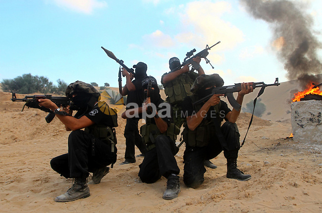 Palestinian militants from the Popular Resistance Movement participate in a training session in the southern Gaza Strip town of Khan Younis on Sept.30,2011. Israel on Tuesday approved construction of 1,100 homes for Jews on the annexed land in the West Bank, a move that could complicate international efforts to renew peace talks and defuse a crisis over a Palestinian statehood bid at the United Nations. Photo by Ashraf Amra