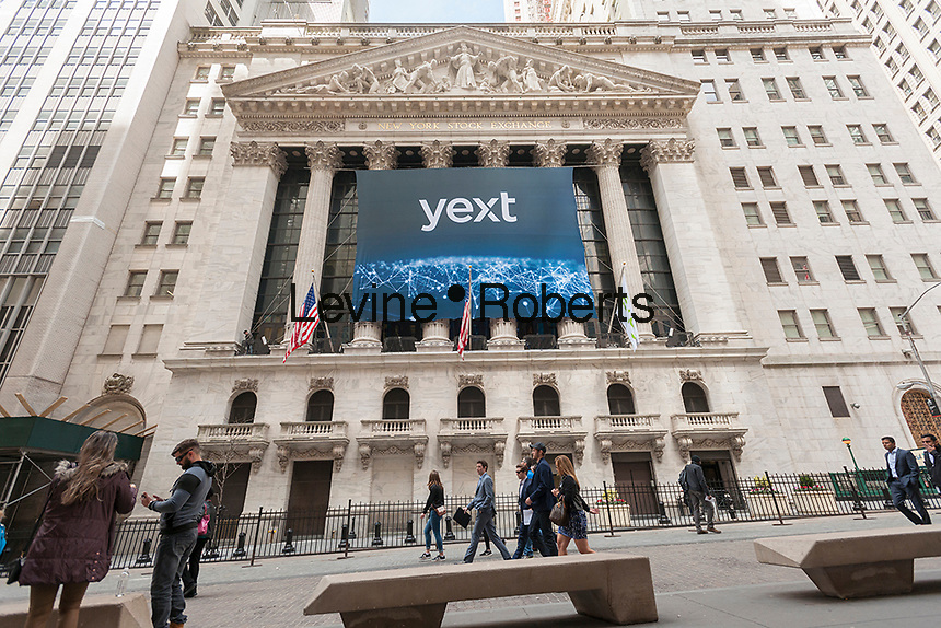 The New York Stock Exchange is decorated for the initial public offering of the technology company Yext on Thursday, April 13, 2017. The New York based Yext provides a cloud-based technology that enables companies to manage their listings across various search engines.  (© Richard B. Levine)