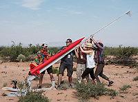 The team from North Seattle College with prep their team rocket before a launch at the Spaceport America Cup near the town of Truth or Consequences, New Mexico, Friday, June 23, 2017. The International Intercollegiate Rocket Engineering Competition hosted over 110 teams from colleges and universities in eleven countries. Students launched solid, liquid, and hybrid rockets to target altitudes of 10,000 and 30,000 feet. The 2017 Spaceport America Cup winner was the University of Michigan, Ann Arbor, Team 79.<br /> <br /> Photo by Matt Nager
