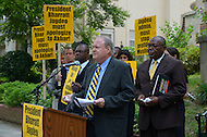July 19, 2011 (Washington, DC)  Attorney Martin F. McMahon (c) and Akbar Muhammad (r), the International Representative of Louis Farrakhan and the Nation of Islam, held a press conference in front of the Embassy of Guyana, announcing a $15 million dollar lawsuit against the government of Guyana.  Mr. Muhammad alleges he was falsely detained in Guyana on May 19, 2011, for what he describes as fabricated charges of drug trafficking and terrorism.  He was later released without being formally charged.  Muhammad maintains his innocence, claiming the allegations were fabricated to tarnish his image, character and reputation.  He also sought an apology from the Guyanese government, but Bharrat Jagdeo, President of Guyana, has refused to apologize. (Photo by Don Baxter/Media Images International)