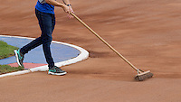 13 SEP 2014 - IPSWICH, GBR - A volunteer sweeps the track to remove ruts before the start of the 2014 British Open & Women's Club Cycle Speedway Championships at Whitton Sports & Community Centre in Ipswich, Great Britain (PHOTO COPYRIGHT © 2014 NIGEL FARROW, ALL RIGHTS RESERVED)