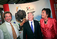 NO REPRO FEE: 27.1.12: Minister of State at the Department of Tourism, Michael Ring TD, officially opens the Holiday World Show Dublin at the RDS Simmonscourt. Pictured at the Visit Louth stand was Lothar F. Muschketat from the Irish Raptor Research Centre and his American Eagle with Minister of State at the Department of Tourism, Michael Ring TD and Maureen Ledwith, organiser of Holiday World Show. The Show runs until 5.30pm on Sunday 29th January.  Picture Collins Photos.
