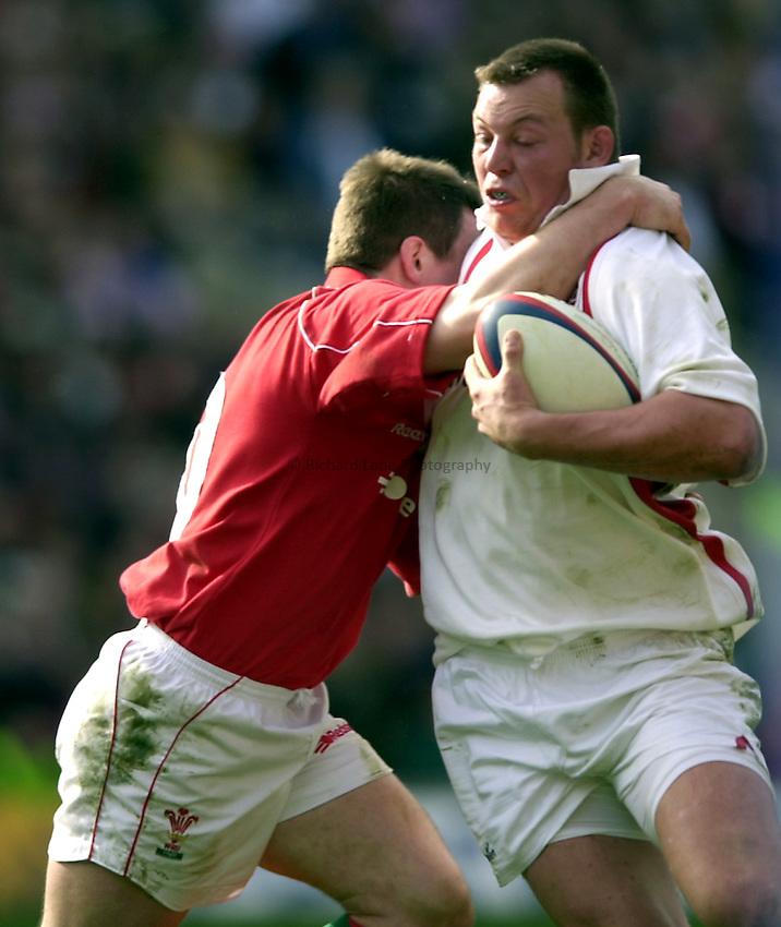 Photo. Richard Lane.Lloyds TSB Six Nations Championship. England v Wales at Twickenham. 23-3-2002.Steve Thompson is tackled.