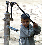 A boy pumps water in the Lower Sindh River Valley in Pakistan..
