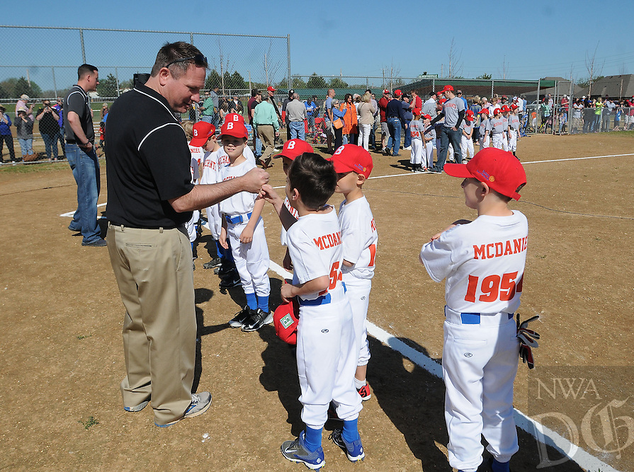 NWA Democrat-Gazette/ FLIP PUTTHOFF<br /> PLAY BALL<br /> David Wright, Bentonville director of parks and recreation, greets youth baseball players before the dedication of Merchants Baseball Park at 201 N.W. Elm Tree Road in Bentonville. The park was renovated from a bare-bones practice site and contains four new ball fields, concession building, new parking areas, walkways and more. Cost was $700,000, mainly for the concession building and parking areas, Wright said. The park is named for the Bentonville Merchants semi-professional baseball team which was in the city during the 1940s through the early 1960s. Lindy McDaniel, a former Merchants player who went on to the major leagues, helped dedicate the ballpark with Bentonville city officials and other former Merchants players. McDaniel had a 20-year career in major league baseball from 1955 to 1975 with the Cardinals, Cubs, Yankees and Royals. Teams of 6- and 7-year olds in the Bentonville Youth Baseball program will play at the park.
