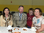 John and Joan Murphy, Jackie and Aidan McGovern enjoy a cup of tea after Fr Sean Dooley's 25th anniversary mass at the Church of Our Lady of the Assumption Tullyallen. Photo:Colin Bell/pressphotos.ie