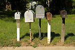 Five street-side mail boxes