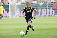 Stephanie Cox #14 of the Los Angeles Sol attacks the defense of the Washington Freedom during their inaugural match at Home Depot Center on March 29, 2009 in Carson, California.