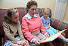 Grandmother reading granddaughters a story,