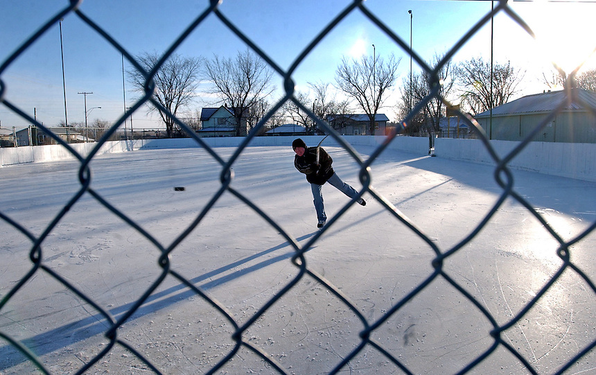 Adam Van Biert braves bitterly cold weather to work on his wrist shot at the Kinsmen East End Playground rink. MARK TAYLOR GALLERY
