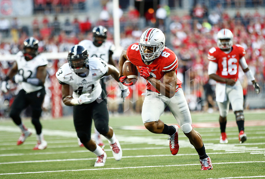 Ohio State Buckeyes wide receiver Devin Smith (9) runs for a touchdown after a receptions in the second quarter of the college football game between the Ohio State Buckeyes and the Cincinnati Bearcats at Ohio Stadium in Columbus, Saturday afternoon, September 27, 2014. As of half time the Ohio State Buckeyes led the Cincinnati Bearcats 30 - 21. (The Columbus Dispatch / Eamon Queeney)