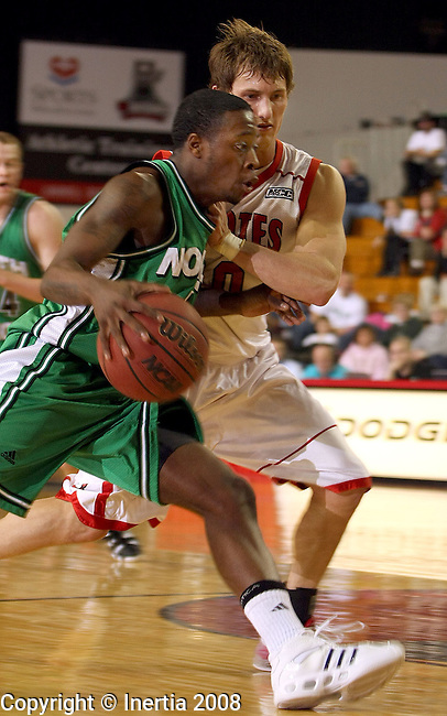 VERMILLION, SD - FEBRUARY 21: Ervin Youmans #5 of the University of North Dakota tries to get a step past Jesse Becker #10 of the University of South Dakota in the first half of their NCAA basketball game Thursday night at the DakotaDome in Vermillion. (Photo by Dave Eggen/Inertia)