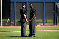 Umpire Chad Westlake (left) discusses a call with Jaylen Goodman (right) during a Gulf Coast League game between the GCL Mets and GCL Astros on August 10, 2019 at FITTEAM Ballpark of the Palm Beaches Training Complex in Palm Beach, Florida.  GCL Astros defeated the GCL Mets 8-6.  (Mike Janes/Four Seam Images)