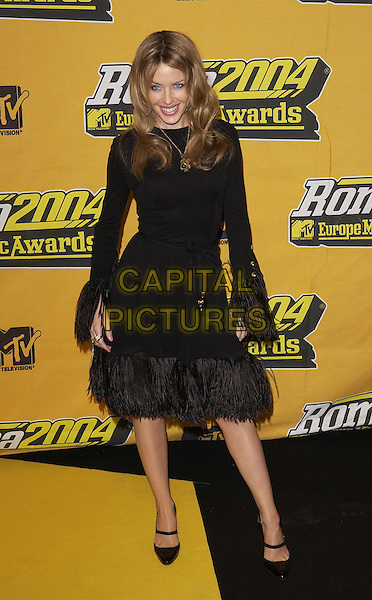 KYLIE MINOGUE.MTV Europe Music Awards 2004.November 18th, 2004.full length, black dress, feather trim.www.capitalpictures.com.sales@capitalpictures.com.©Capital Pictures