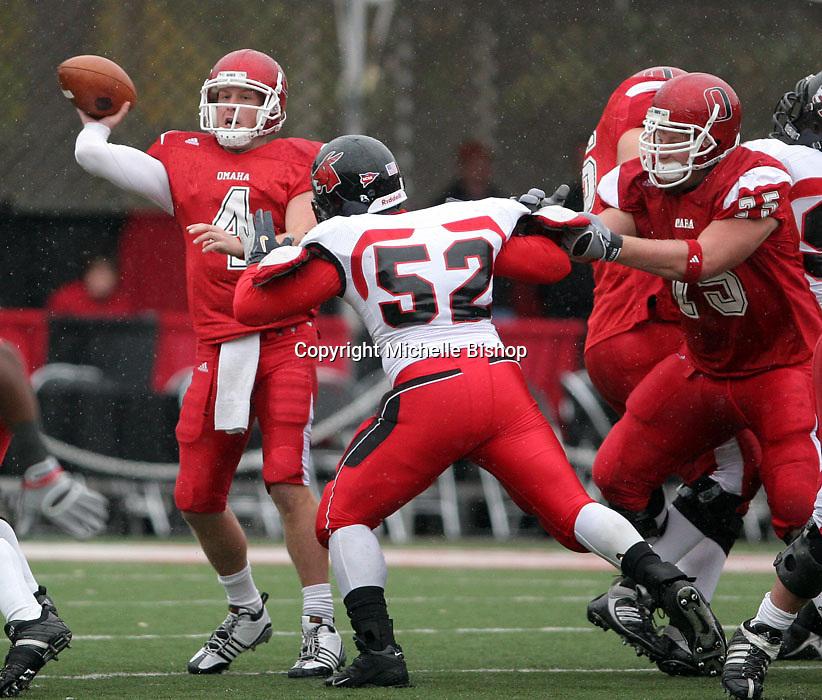 Nebraska-Omaha quarterback Greg Wunderlich looks to get rid of the ball.
