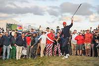 Dustin Johnson (USA) watches his approach shot on 15 during round 3 Four-Ball of the 2017 President's Cup, Liberty National Golf Club, Jersey City, New Jersey, USA. 9/30/2017.<br /> Picture: Golffile | Ken Murray<br /> <br /> All photo usage must carry mandatory copyright credit (&copy; Golffile | Ken Murray)