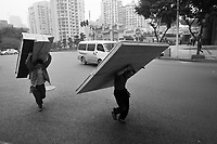 Men Carrying Heavy Building Materials In The Street In Chongqing, China.  © LAN