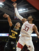 NWA Democrat-Gazette/ANDY SHUPE<br /> Arkansas guard Jimmy Whitt Jr. (33) and Northern Kentucky forward Dantez Walton reach Saturday, Nov. 30, 2019, for a rebound during the second half of play in Bud Walton Arena. Visit nwadg.com/photos to see more photographs from the game.