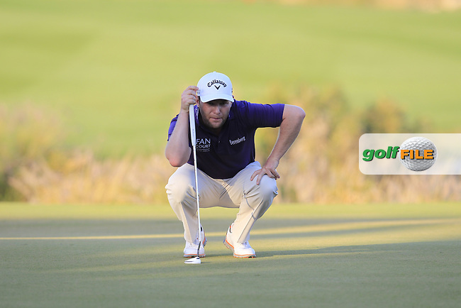 Branden GRACE (RSA) lines up his putt on the 18th green during Saturday's Final Round of the 2015 Commercial Bank Qatar Masters held at Doha Golf Club, Doha, Qatar.: Picture Eoin Clarke, www.golffile.ie: 1/24/2015