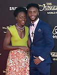 Lupita Nyong'o and guest attends The Disney World Premiere of The Jungle Book held at The El Captian theatre  in Hollywood, California on April 04,2016                                                                               © 2016 Hollywood Press Agency