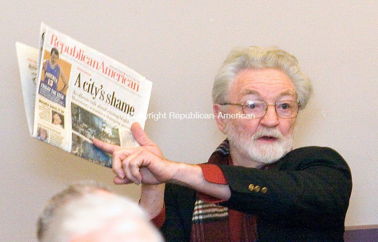 WATERBURY, CT- 14 APRIL 2007-041407JW01.jpg -- Spencer Parrish of the Waterbury Main St. organization holds up the Friday edition of the Republican-American asking when blight problems might be solved during a litter summit at the Waterbury Regional Chamber Saturday morning. Jonathan Wilcox Republican-American
