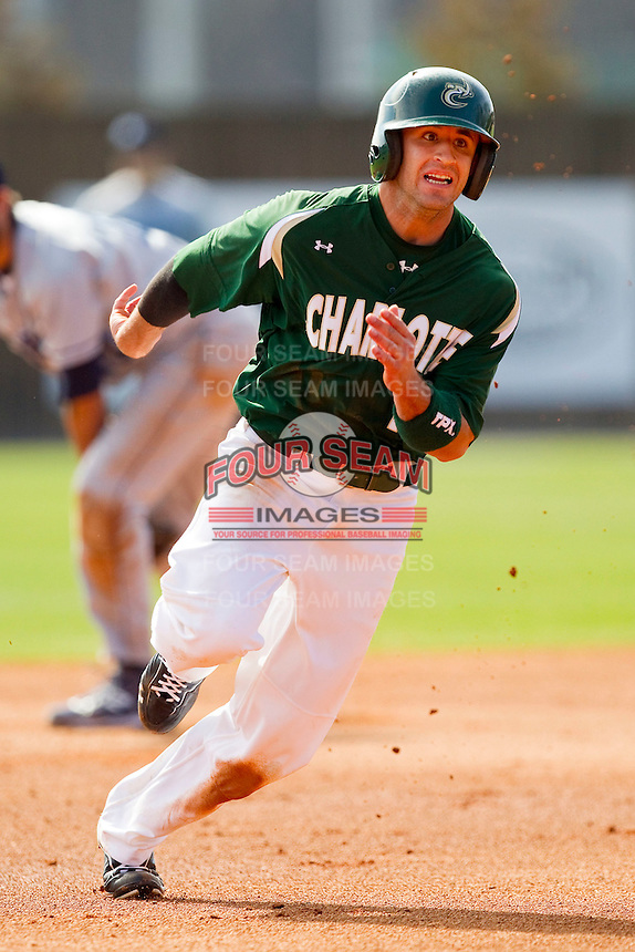 J.J. Elseser #17 of the Charlotte 49ers hustles towards third base against the Saint Peter's Peacocks at Robert and Mariam Hayes Stadium on February 18, 2012 in Charlotte, North Carolina.  Brian Westerholt / Four Seam Images